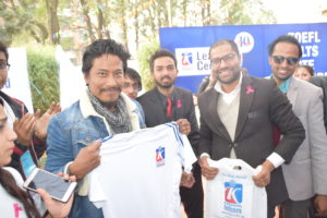 Nischal Basnet with KIEC Tshirt